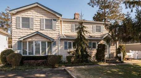 This four-bedroom, two-bathroom Colonial on Rushmore Avenue in