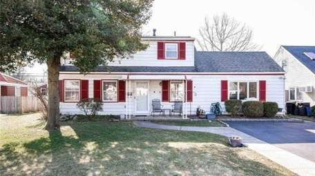 Priced at $559,000, this five-bedroom, two-bathroom Colonial is