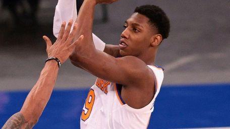 Knicks guard RJ Barrett shoots over Wizards guard