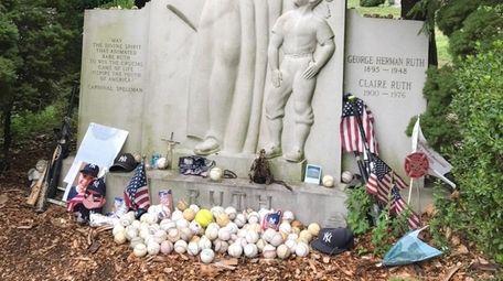 Memorabilia at Ruth's grave last summer includes Jake's