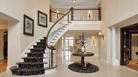 The house has a grand, double-height foyer.