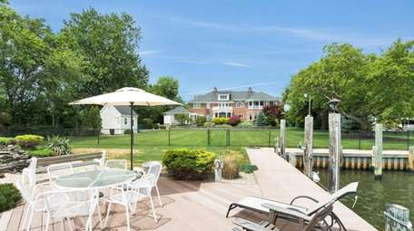 The property includes an in-ground pool and hot