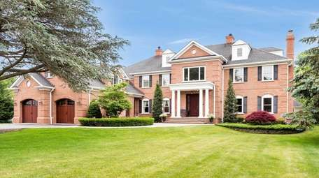 The solid brick house is unusual for a