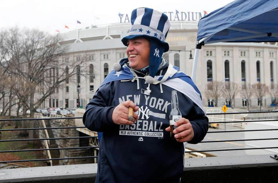 New York Yankee fan Edward Montoya attends the