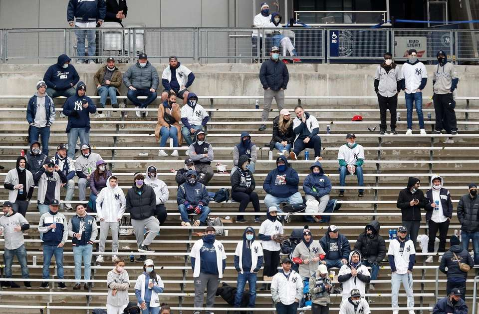 Fan watch the Opening Day game between the