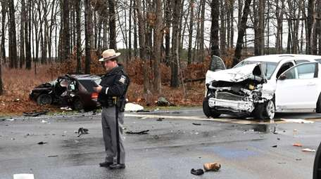 Police investigate a two-vehicle collision at Middle Country