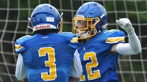 Maximus Mongelli #12 of Kellenberg, right, gets congratulated