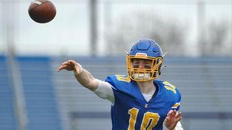 Thomas Sluka #10, Kellenberg quarterback, throws a pass