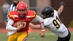 Chaminade quarterback, Tyler Burke runs past Shawn McCabe