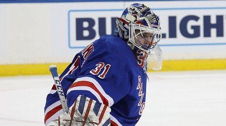 The Rangers' Igor Shesterkin makes a save against
