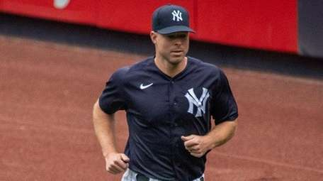 Yankees pitcher Corey Kluber warms up in the