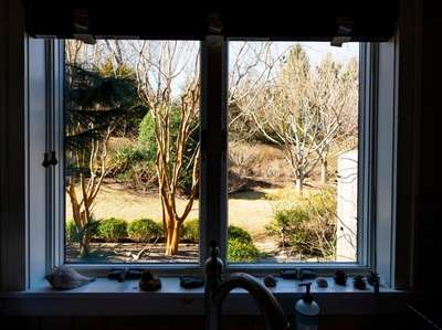 The kitchen window frames seasons of color, with