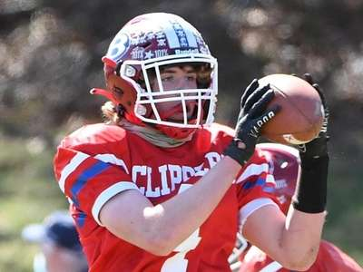 Bellport's Calvin Pedatella reacts after scoring a two-point