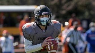 Daniel Baskind, quarterback for Friends Academy, looks to