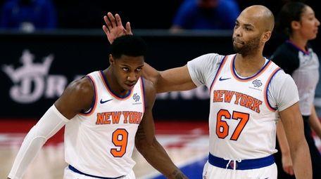 Knicks guard RJ Barrett receives a pat on