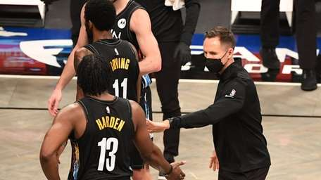 Nets head coach Steve Nash slaps five with