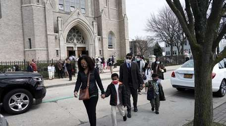 Congregants outside St Agnes Cathedral after Easter services