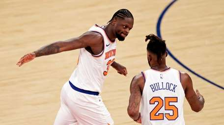 Knicks forward Reggie Bullock (25) is congratulated by