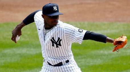 Domingo German of the Yankees pitches during the