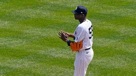 Yankees starting pitcher Domingo German reacts during the