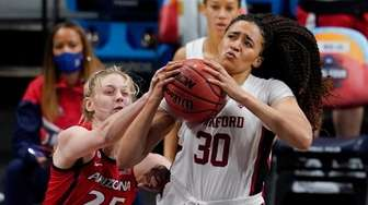Stanford guard Haley Jones (30) drives to the