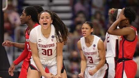 Haley Jones #30 of the Stanford Cardinals celebrates