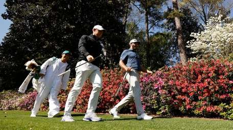 Rory McIlroy and Dustin Johnson walk to the