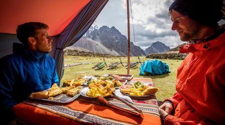 Mountain bikers riding through Peruvian Andes take a