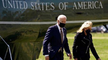 President Joe Biden walks from Marine One with