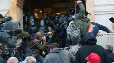 Supporters of President Donald Trump fight police at