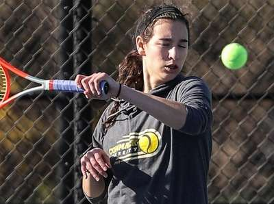 Commack's Emily Tannenbaum drives the ball over the