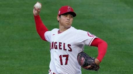 Angels starting pitcher Shohei Ohtani throws during the