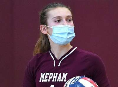 Samantha Green #1 of Mepham spikes for a