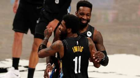 Kyrie Irving of the Nets celebrates a late