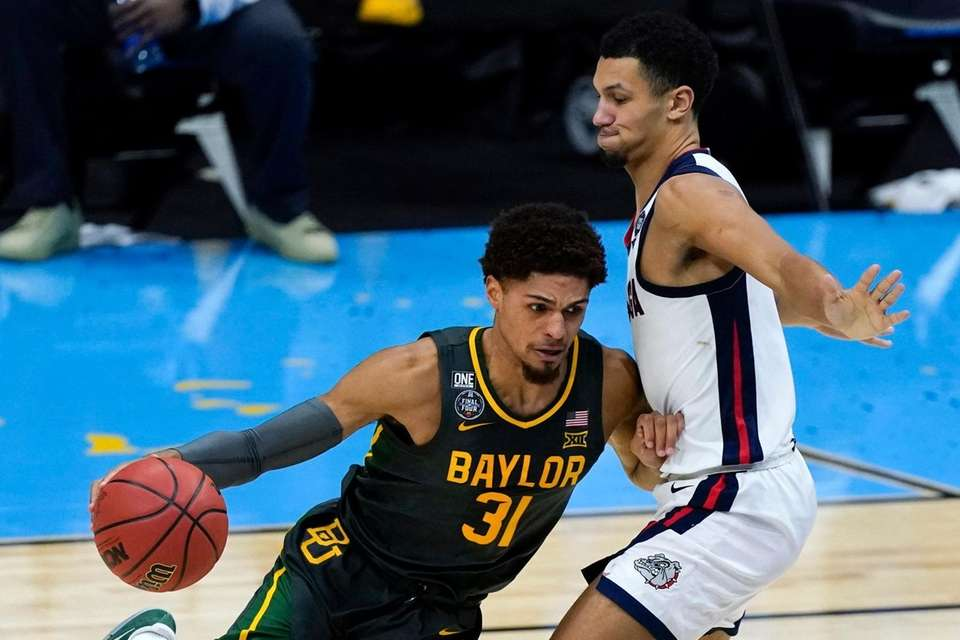 Baylor guard MaCio Teague (31) drives around Gonzaga