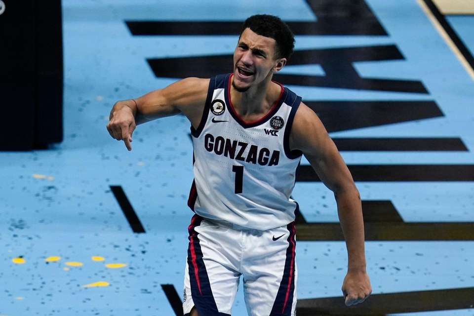 Gonzaga guard Jalen Suggs (1) celebrates after making