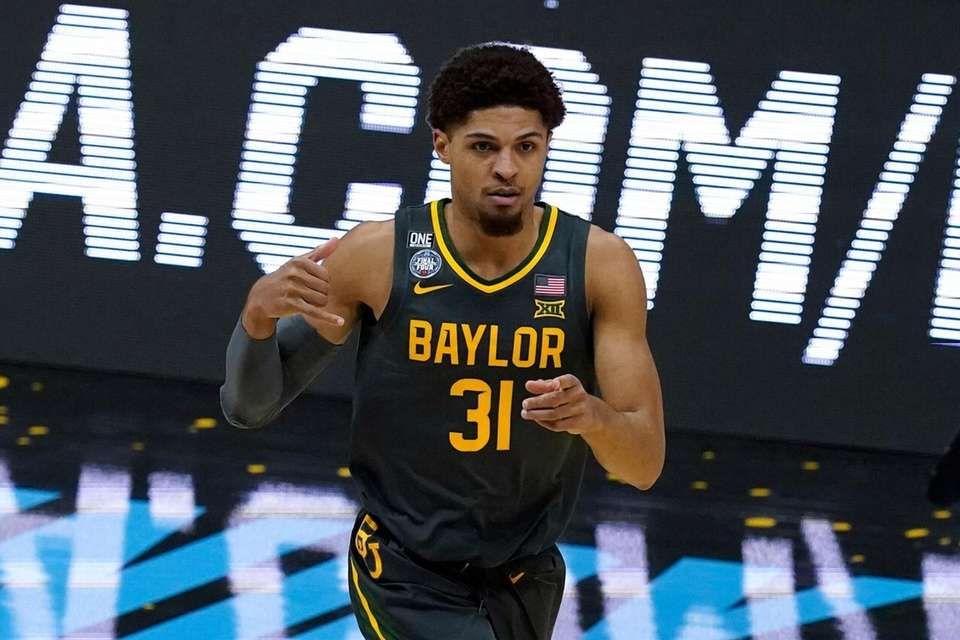 Baylor guard MaCio Teague (31) celebrates after making
