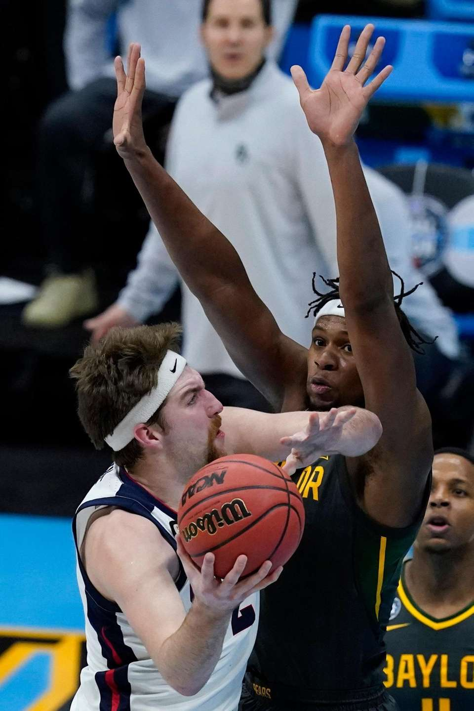 Gonzaga forward Drew Timme, left, shoots over Baylor