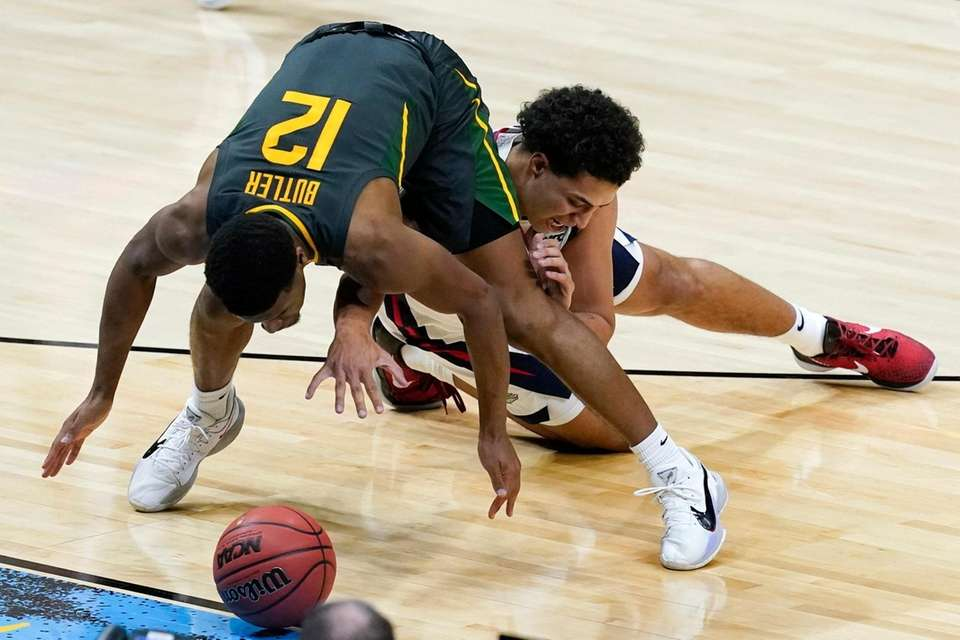 Baylor guard Jared Butler (12) fights for a