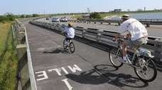 Cyclists ride the bike path along Wantagh Parkway.