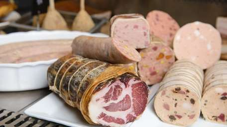 A variety of freshly made charcuterie including capacola,