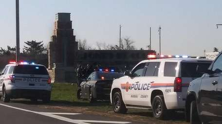 """Officers at the """"Welcome to Jones Beach"""" monument"""