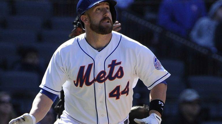 Mets catcher John Buck watches his sacrifice fly
