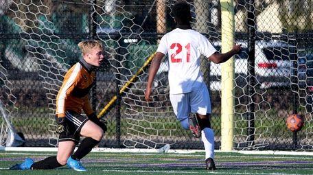 Amityville midfielder Bryce Cherry puts his shot past