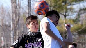 Amityville forward Fernando Nunez heads the ball into