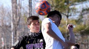 Amityville forward Fernando Nunez heads the ball into