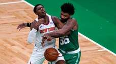 Boston Celtics guard Marcus Smart (36) fouls Knicks