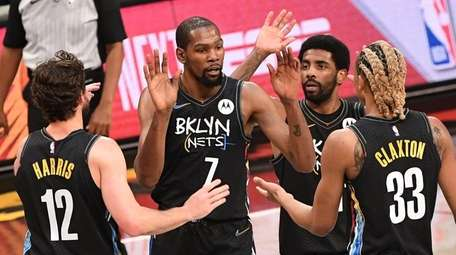 Nets forward Kevin Durant and teammates react against