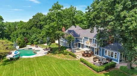 This six-bedroom home on almost 1.8 acres in