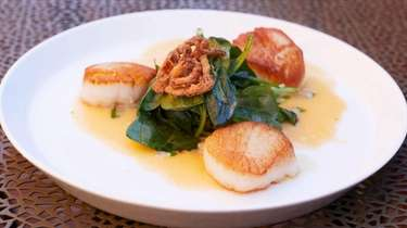 Pan seared diver scallops with crispy shallots, microgreens,